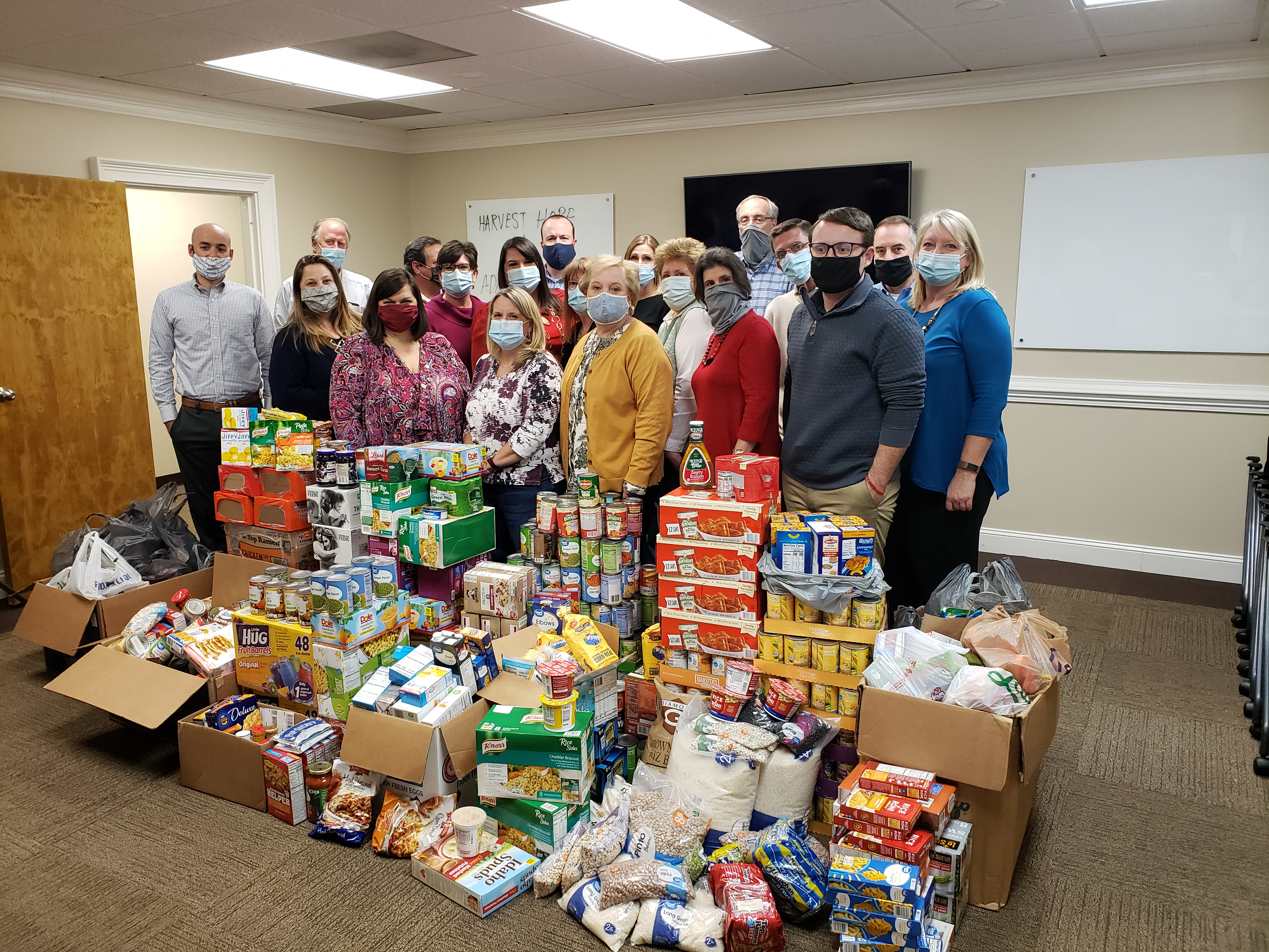 AEA Employees standing with Food Drive Donations
